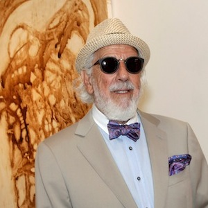 Lou Adler in tan suit at Herb Alpert's