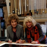 Carol Beckwith and Angela Fisher siging a print for Minotti Los Angeles Exhibition Nov 2012