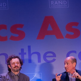 "Moderator Michael Lynton (far left) and panelist Howard grodon (third from left) have a spirited exchange during the ""Hollywood and Policy"" panel discussion Friday, Nov. 16 at the RAND Politics Aside event in Santa Monica as fellow panelists Michael Sheen (second from left) and David Nevins (far right) look on (Picture and caption courtesy of RAND.org)"